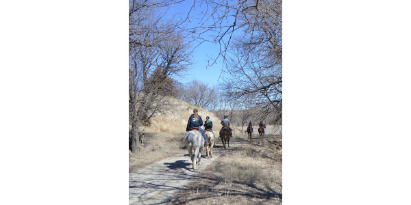 Equine students ride down a trail to Aggieland north of the NCTA campus in Curtis. (Crawford/NCTA News)