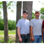 Three generations of the Pemberton family improved their Monroe County acreage to put a rotational grazing system in place. Family members include, from left, Cade, Brian and Richard. (Photo by Linda Geist)