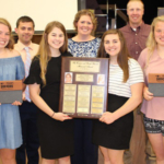 The winning senior team will represent Iowa at the 2019 National Dairy Quiz Bowl. Front row: Tara Goedken, Lauren Goldsmith, Amber Engelken, Sarah Goedken. Back row: Team coaches – Josh Thibadeau, Jennifer Zumbach, Brian Bagge. (Courtesy of ISU Extension and Outreach)