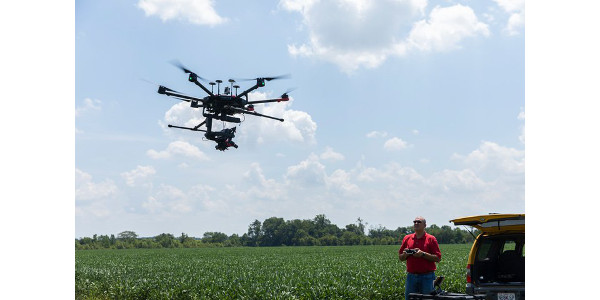 Andy Chronister, agriculture technology coordinator in Southeast's Economic and Business Engagement Center, operates the new hyperspectral camera and DJI Matrice 600 drone at Southeast's David M. Barton Agriculture Research Center in Cape Girardeau. (Courtesy of Southeast Missouri State University)