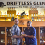 Wisconsin Corn Promotion Board President Randy Woodruff (right) presents the 2019 Heartland Whiskey Competition's Best of Wisconsin award to Nathan Mahinski, Distiller at Driftless Glen Distillery. (Courtesy of Wisconsin Corn)