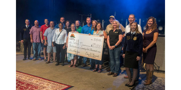 Missouri Farmers Care Drive to Feed Kids culminated Sat., Aug. 17, at the Missouri State Fair with a check presentation to Feeding Missouri. Through the Drive to Feed Kids, Missouri agriculture packed 128,460 meals, 1,740 backpack meals, donated thousands of pounds of canned food, and raised $175,000 for Missouri families facing food insecurity. Missouri Farmers Care Drive to Feed Kids is presented in partnership with Bayer and Brownfield Ag News with support from the Missouri State Fair, Missouri FFA and Missouri Department of Agriculture, along with many organizations and individuals across Missouri agriculture. (Photo Credit: Allison Jenkins, MFA Incorporated)