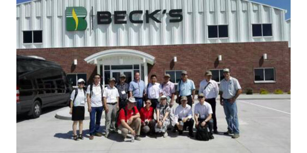 Teng Lim, front row, first from left, and a group of international visitors toured a local seeds company during their visit. (Photo courtesy Teng Lim)