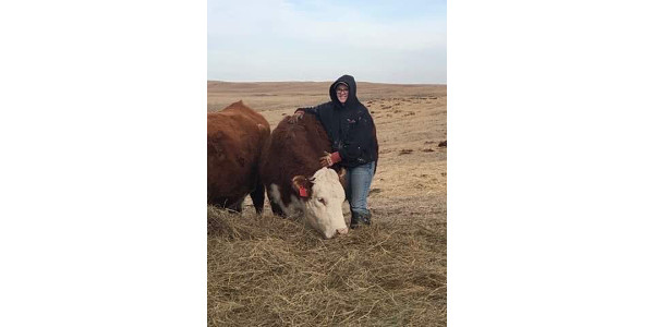 Katie Nolles is the sixth generation on her parents ranch in Bassett, which is a diverse operation. They raise purebred Herefords, run a custom embryo placement business, and raise a few F1 baldy calves. After college she hopes to teach agriculture education and serve as an FFA advisor in a rural community. Eventually, she will return to my family's ranch and work in consulting. (Courtesy of NeFB)