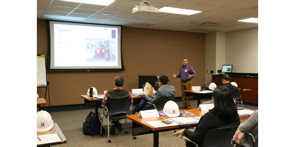 Carlos Campabadal, IGP Institute feed manufacturing and grain quality management outreach specialist, discusses the method of delivery of the course to the participants of the U.S. Grains Council Sorghum and DDGS Seminar. (Courtesy of KSU)