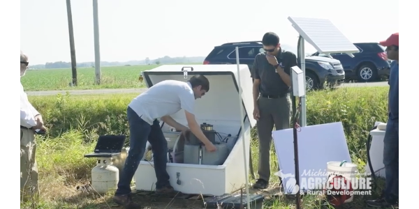 Members of the Michigan Cleaner Lake Erie through Action and Research (MI CLEAR) recently visited an edge-of-field water quality monitoring project site in Lenawee County. (Screenshot from video)