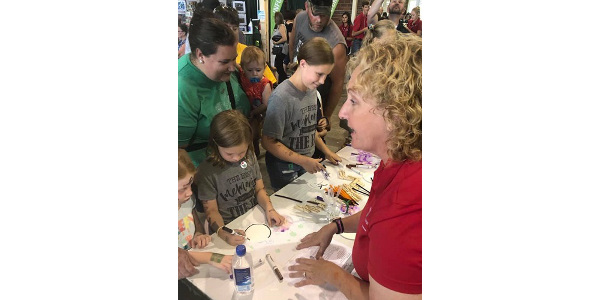 Youth visiting the 4-H Exhibition Hall at the Iowa State Fair had the opportunity to participate in hands-on activities during this year's STEM event hosted by Bayer. (Courtesy of ISU Extension and Outreach)