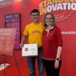 David Hora receives Best of Show award from Iowa State University President Wendy Wintersteen. (Courtesy of ISU Extension and Outreach)