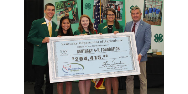 Agriculture Commissioner Ryan Quarles presented ceremonial Ag Tag checks to state 4-H officers (top) and FFA officers at the Kentucky State Fair in Louisville on Friday. (Kentucky Department of Agriculture photos)