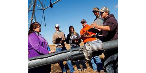 Mary Rittenhouse, Agri Business Management professor, visits with students about costs of production at the NCTA Farm. For high school students in dual credit courses, she teaches two online classes, Introduction to Ag Economics and Principles of Microeconomics. (Chandler/NCTA Photo)