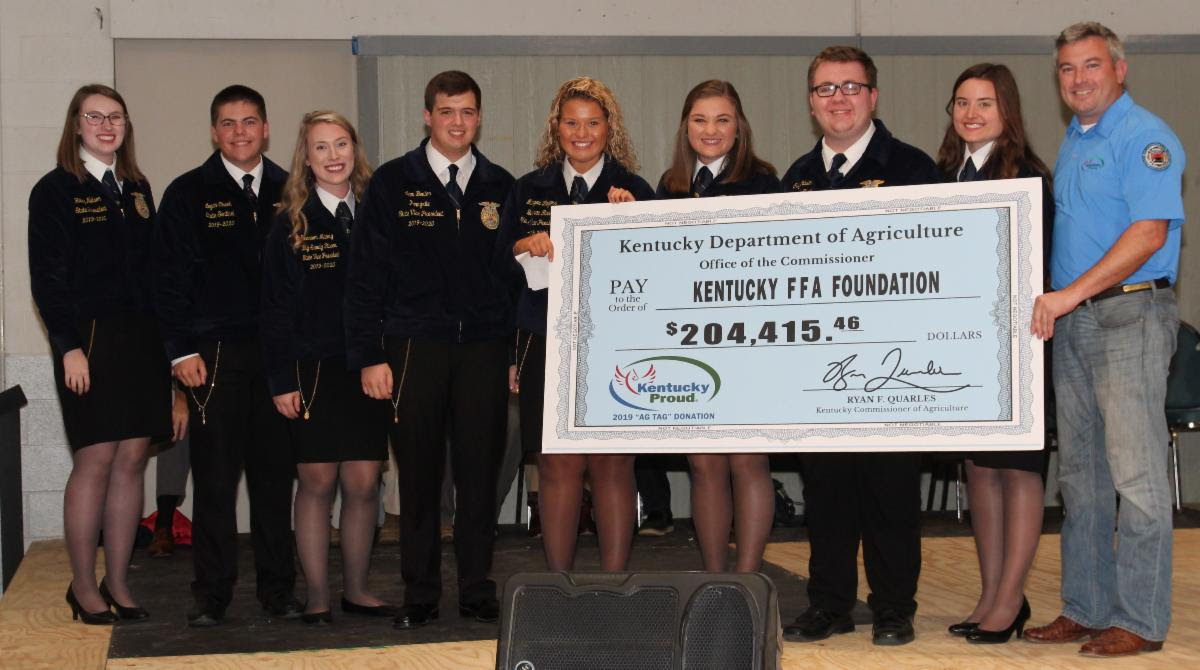 Agriculture Commissioner Ryan Quarles presented ceremonial Ag Tag checks to FFA officers at the Kentucky State Fair in Louisville on Friday. (Kentucky Department of Agriculture photos)