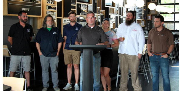 Agriculture Commissioner Ryan Quarles, center, joins Kentucky craft brewers to announce the Kentucky Proud Beer Series on Tuesday at Gravely Brewing Co. in Louisville. (Kentucky Department of Agriculture photo)