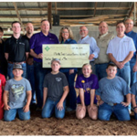 FCS Financial Rural Community and Agriculture Foundation presents $12,000 to the Platte County Livestock Boosters for the renovation of their wash rack facilities at the Platte County Fairgrounds. (Courtesy of FCS Financial)