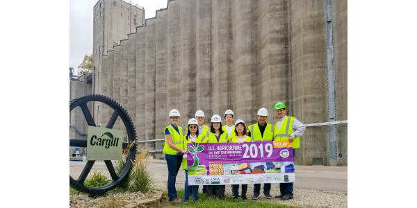 Participants of the U.S. Soybean Export Council (USSEC) Southeast Asia Trade Team stand for a group photo in front of the Cargill Grain Terminal In Topeka, Kansas. (Courtesy of Kansas State University)
