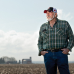 Mike Cerny is shown in a recently planted soybean field on his farm near Sharon, Wis., in early May 2019. (Photo by Michael P. King)