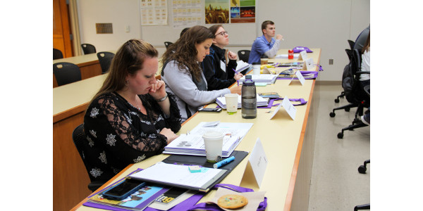 Participants of the IAOM-KSU Flour and Dough Analysis course take notes during an equipment demonstration. The course took place from September 10-12. (Courtesy of KSU)