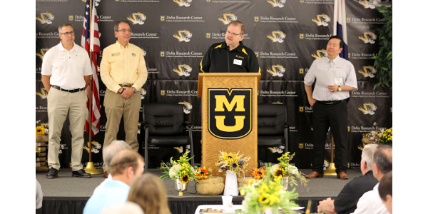 From left, Christopher Daubert, dean of the MU College of Agriculture, Food and Natural Resources; MU Vice Chancellor for Extension and Engagement Marshall Stewart; MU Chancellor Alexander Cartwright; and UM System President Mun Choi at the Fisher Delta Research Center in Portageville, Mo., on Aug. 30, 2019. University officials announced a $6.5 million investment in MU's network of agricultural research centers, including Delta Center. (Courtesy of University of Missouri Extension)