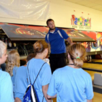 Cody Shannon explains the mechanics behind a his bowling alley to children attending Fleming County's Community Passport Adventure Camp. (Photo by Katie Pratt, UK agricultural communications)