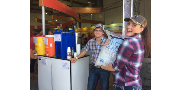 NCTA students Peyton McCord and Kaylee Hostler greeted visitors with refreshments in the University of Nebraska building at Husker Harvest Days. (Courtesy of NCTA)