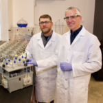 Iowa State University professor Jacek Koziel (right), agricultural and biosystems engineering, and research collaborator Devin Maurer, with a prototype of their new tool that can dramatically speed detection of bovine tuberculosis by identifying the unique signature of gases different microbes emit over time. (Courtesy of ISU Extension and Outreach)