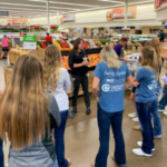 The 2019 class of the Corn and Soy Ambassador Program participate in a grocery store tour with their Dairy Ambassador counterparts. (Courtesy of NCGA)
