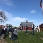 Regent Cris Peterson welcomes University of Wisconsin System officials, UW Regents, guests, and the media to a tour of her family dairy farm, Four Cubs Farm. (Courtesy of University of Wisconsin System)