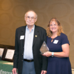 Morris Burger, left, of Burgers' Smokehouse, receives the inaugural Missouri 4-H Champion Award from Missouri 4-H Foundation trustee Elaine Anderson, right. (Photo by Casey Buckman)