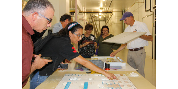 Participants of the USDA Cochran Tunisia Market Reform within the Wheat Value Chain look at the various wheat consistencies while touring Kansas State University's Hal Ross Flour Mill. (Courtesy of KSU)