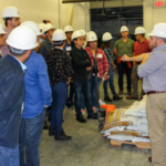 Carlos Campabadal (far right), shows different types of feed products at the O.H. Kruse Feed Technology Innovation Center for participants of the RAPCO Feed Manufacturing course. (Courtesy of KSU)