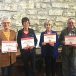 Receiving certificates were Barb Recker and Julie Vandermeer for 5 years of service and Susanne Reiter and Bob Wendt for 10 years of service. (Courtesy of ISU Extension and Outreach)