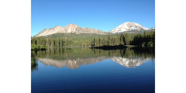 Protected lakes in the continental U.S. tend to occur in relatively remote, mountainous western states where freshwater biodiversity is low and there are relatively few lakes. In contrast, freshwater biodiversity is greatest in the southeastern U.S. where there are relatively few protected areas. Pictured here is Manzanita Lake (Lassen Volcanic National Park, California). (Photo by Ian McCullough)