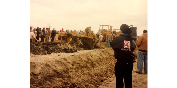 After the 1993 flood, MU Extension and other agencies sponsored a demonstration of a Post plow on land where Mike and Brian Strider farm. The plow turned up soil to mix with sand deposits left by floodwaters. Photo courtesy of Willie Aholt.