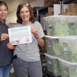 Carol (right) with Montello School District, accepting their complimentary lettuce delivery from Nelson and Pade, Inc.® team member, Kate (left). (Courtesy of Nelson and Pade, Inc.®)