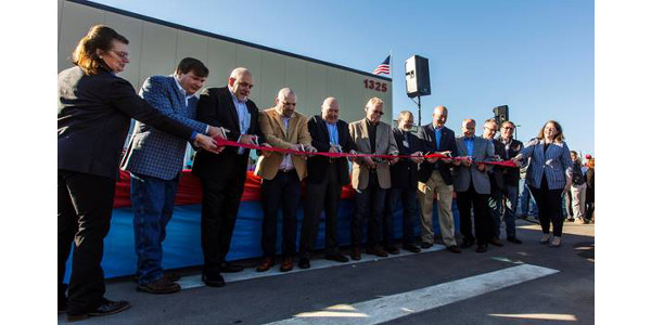 Gov. Ricketts (fifth from right) helps cut the ribbon at the ceremony. (Courtesy of Governor Pete Ricketts)