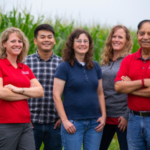 Professor Michelle Soupir (left), and the team of Iowa State researchers in the Department of Agricultural and Biosystems Engineering who have been involved with a long-term study on the impacts of fertilizing cropland with poultry manure. Others, from left: Ji Yeow Law, research associate; Leigh Ann Long, research associate; Natasha Hoover, research associate; and Rameshwar Kanwar, Charles F. Curtiss Distinguished Professor in Agriculture and Life Sciences, who initiated the 20-year project. (Photo by Chris Gannon)