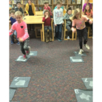 Life is a flyway! Students at Delhi Elementary (Maquoketa Valley CSD) learn about the importance of wetlands as they compete in Habitat Hopscotch. (Courtesy of ISU Extension and Outreach)