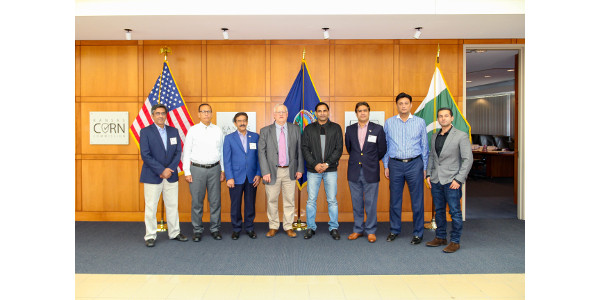 Participants of the USSEC Pakistan Trade Group Procurement course stand with the IGP Institute's senior economist and course curriculum manager, Guy Allen. (Courtesy of KSU)