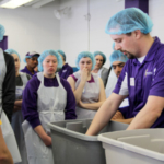 "Jason Watt, Buhler Instructor of Milling, demonstrates to the prospective students how to create a ""Wet Slick"". This hands-on activity is used to show differences in quality of different types of flour. (Courtesy of KSU)"
