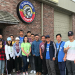 Mike Klem (back row, left) visits the Quapaw Nation's Coffee Roasting Facility with a group of international students. (Courtesy of Missouri State University)