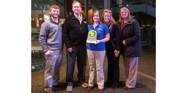Nelson and Pade, Inc. Management Team and Owners, accepting their Force for Positive Change Award. From left to right: Tim Dobbins, John Pade, Erin Kuhn, Jannel Dunn and Rebecca Nelson. (Courtesy of Nelson and Pade, Inc.)